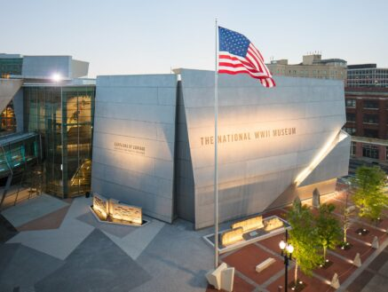 National WWII Museum in New Orleans with American flag in front